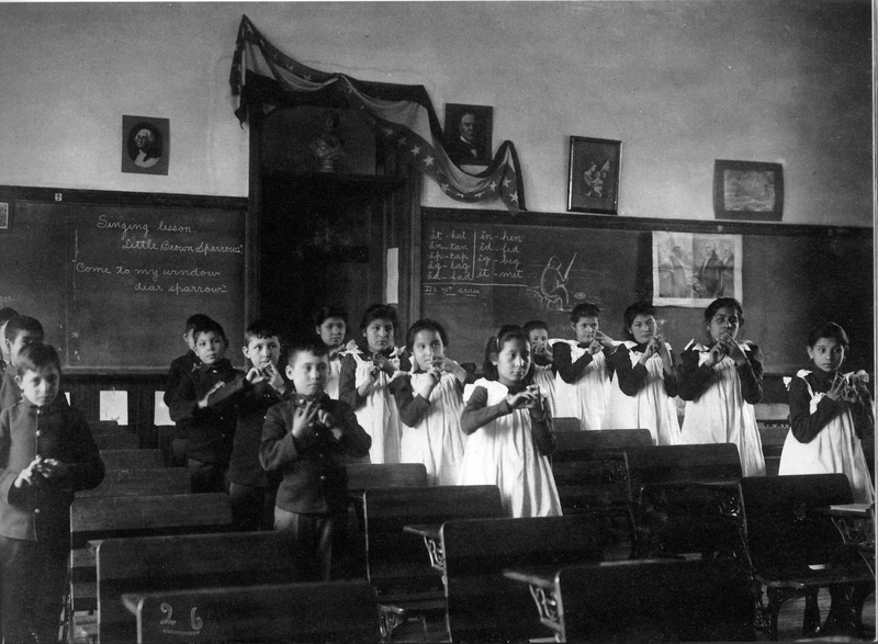 Sioux children practicing lessons