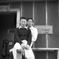 Two young men sitting in front of the Shimizu barrack