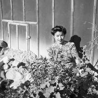 Koto Hirahara kneeling in her garden