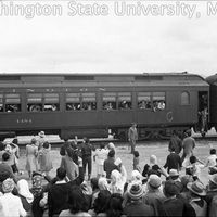 Crowd watching a train departing to the Tule Lake Relocation Center
